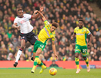 Bolton Wanderers' Sammy Ameobi battles with  Norwich City's Jamal Lewis<br /> <br /> Photographer David Shipman/CameraSport<br /> <br /> The EFL Sky Bet Championship - Norwich City v Bolton Wanderers - Saturday 8th December 2018 - Carrow Road - Norwich<br /> <br /> World Copyright &copy; 2018 CameraSport. All rights reserved. 43 Linden Ave. Countesthorpe. Leicester. England. LE8 5PG - Tel: +44 (0) 116 277 4147 - admin@camerasport.com - www.camerasport.com