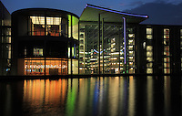 Paul-Lobe-Haus at night, architect Stephane Braunfels, 2001, a government building for the new parliamentary complex in the new government quarter of Berlin, on the banks of the river Spree on Federal Row, Berlin, Germany. It is connected to the Chancellery and together with the Marie-Elisabeth-Luders House on the opposite side of the Spree it forms a formal and functional whole. The building contains more than 900 offices for the parliamentary deputies. It is named after Paul Lobe, 1875-1967, the last democratic president of the Weimar Republic. Picture by Manuel Cohen