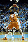 18 December 2013: North Carolina's Brice Johnson (behind) is defended by Texas' Jonathan Holmes (10). The University of North Carolina Tar Heels played the University of Texas Longhorns at the Dean E. Smith Center in Chapel Hill, North Carolina in a 2013-14 NCAA Division I Men's Basketball game. Texas won the game 86-83.