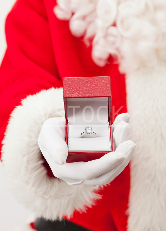 USA, Illinois, Metamora, Santa claus holding ring in jewelry box
