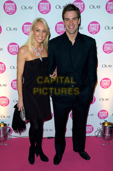 CAMILLA DALLERUP & GETHIN JONES.Cosmopolitan Fun Fearless Female Awards 2007 held at Cirque, Leicester Square, London, England. .November 6th 2007 .full length black strapless dress suit.CAP/CAN.©Can Nguyen/Capital Pictures