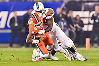 Charlotte, NC - DEC 2, 2017: Clemson Tigers quarterback Kelly Bryant (2) is hit hard by Miami Hurricanes defensive lineman Joe Jackson (99) during ACC Championship game between Miami and Clemson at Bank of America Stadium Charlotte, North Carolina. (Photo by Phil Peters/Media Images International)