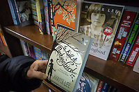 """A reader holds a paperback copy of """"To Kill a Mockingbird"""" by Harper Lee in a bookstore in New York on Wednesday, February 4, 2015. The famed Pulitzer Prize winning author will release her second novel, """"Go Set A Watchman"""", a sequel to Mockingbird published 50 years ago. Watchman was actually written prior to Mockingbird and was recently found after being thought lost. The book will be released July 14. (© Richard B. Levine)"""