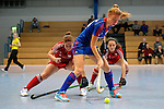GER - Mannheim, Germany, December 19: During the 1. Bundesliga Sued Damen indoor hockey match between Mannheimer HC (blue) and Nuernberger HTC (red) on December 19, 2015 at Irma-Roechling-Halle in Mannheim, Germany. (Photo by Dirk Markgraf / www.265-images.com) *** Local caption *** (L-R) Nina Meller #22 of Nuernberger HTC, Antonia Hering #34 of Mannheimer HC, Salvina Strobel #8 of Nuernberger HTC