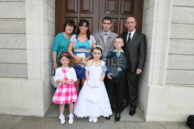 Kathlyn, Chloe, Kathleen, Fiona, Cian and Noel Carter with Michael Thornton at St Brigid's NS Communion in the Lourdes Church....Photo NEWSFILE/Jenny Matthews.(Photo credit should read Jenny Matthews/NEWSFILE)....This Picture has been sent you under the condtions enclosed by:.Newsfile Ltd..The Studio,.Millmount Abbey,.Drogheda,.Co Meath..Ireland..Tel: +353(0)41-9871240.Fax: +353(0)41-9871260.GSM: +353(0)86-2500958.email: pictures@newsfile.ie.www.newsfile.ie.FTP: 193.120.102.198.