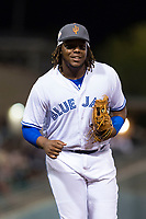AFL West third baseman Vladimir Guerrero Jr. (27), of the Surprise Saguaros and Toronto Blue Jays organization, jogs off the field between innings of the Arizona Fall League Fall Stars game at Surprise Stadium on November 3, 2018 in Surprise, Arizona. The AFL West defeated the AFL East 7-6 . (Zachary Lucy/Four Seam Images)