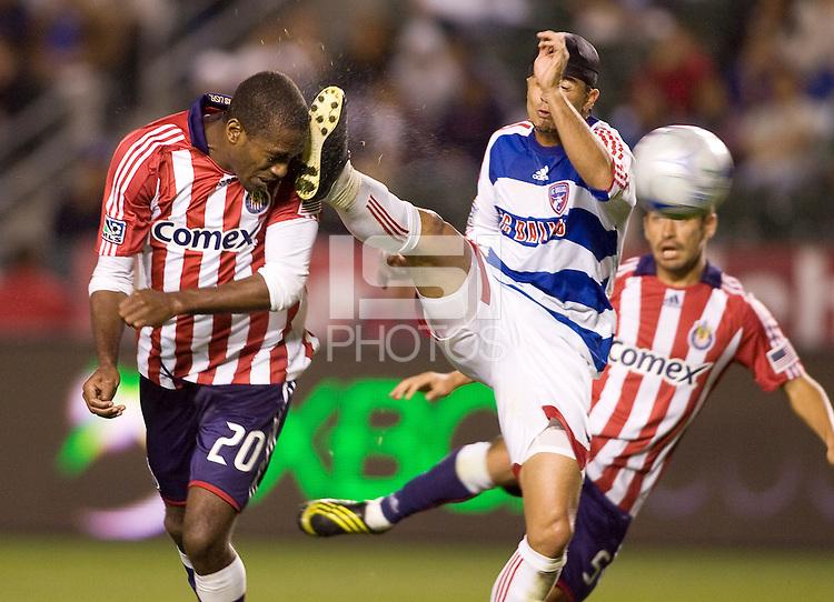 Chivas USA forward Atiba Harris scores as FC Dallas defender Marcelo Saragosa foot hits him in the face. The Chivas USA defeated FC Dallas 2-0 at Home Depot Center stadium in Carson, California on Saturday April 25, 2009.   .