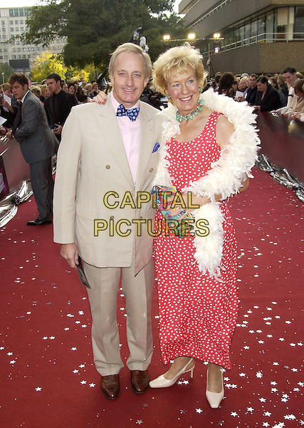 "NEIL & CHRISTINE HAMILTON.ITV's ""The Celebrity Awards"".London 26 September 2004.full length, pink polka dot dress, white feather boa, cream suit, bow tie.www.capitalpictures.com.sales@capitalpictures.com.©Capital Pictures"