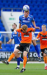 St Johnstone v Dundee United...27.08.11   SPL Week 5.Jamie Adams gets above Stuart Armstrong.Picture by Graeme Hart..Copyright Perthshire Picture Agency.Tel: 01738 623350  Mobile: 07990 594431