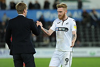 Graham Potter Manager of Swansea City congratulates Oli McBurnie of Swansea City at full time during the Sky Bet Championship match between Swansea City and Derby County at the Liberty Stadium in Swansea, Wales, UK. Wednesday 01 May 2019