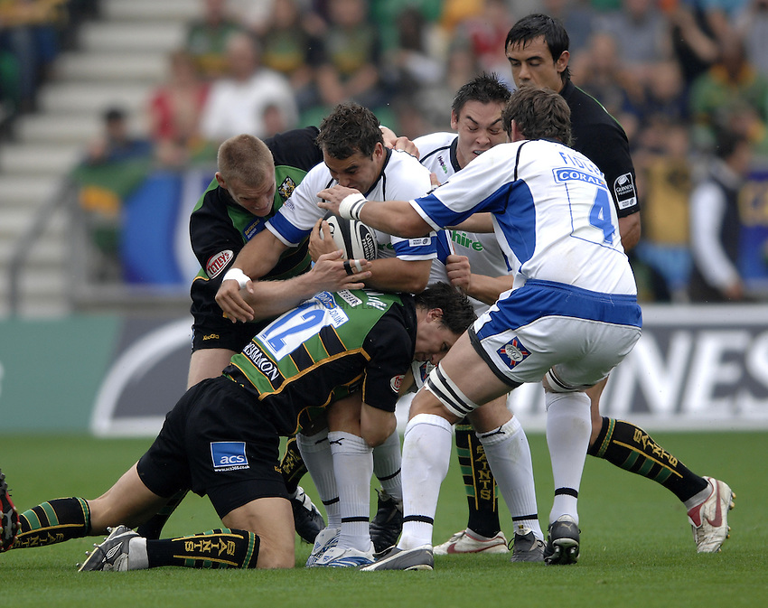 Photo: Richard Lane..Northampton Saints v Bath Rugby. Guinness Premiership. 16/09/2006. .Bath's Olly Barkley is wrapped up by the Saints' defence.
