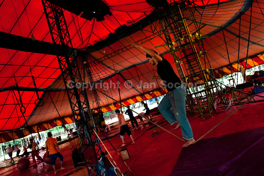 """Students train and exercise during the lessons in the circus school Circo para Todos in Cali, Colombia, 2 June 2012. Circo Para Todos (""""Circus for All""""), founded by Felicity Simpson, a former British circus performer, is the first professional circus school in the world specifically dedicated to disfavoured kids and talented street children. Students are trained in a range of circus art skills including acrobatics, balancing, juggling, stilt walking or unicyling. After finishing the four-year course, graduates may find jobs in circuses in the world or in the cruise ships."""