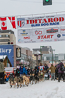 Peter Kaiser  and team leave the ceremonial start line with an Iditarider and handler at 4th Avenue and D street in downtown Anchorage, Alaska on Saturday March 7th during the 2020 Iditarod race. Photo copyright by Cathy Hart Photography.com