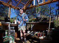 Richard Collins in his greenhouse.