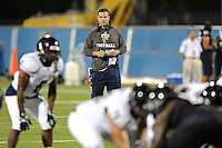 30 March 2012:  FIU Football Head Coach Mario Cristobal watches his players during the FIU Football Spring Game at University Park Stadium in Miami, Florida.