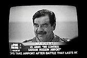 Chicago, Illinois.USA.April 4, 2003..TV images of Saddam Hussein still in power as the airport falls.