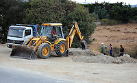 Pictured: Forensic archaeologists assisted by a digger, work at the second site in Kos, Greece. Tuesday 11 October 2016<br />