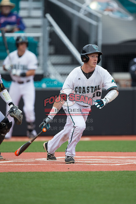 Casey Schroeder (10) of the Coastal Carolina Chanticleers follows through on his swing against the Bryant Bulldogs at Springs Brooks Stadium on March 13, 2015 in Charlotte, North Carolina.  The Chanticleers defeated the Bulldogs 7-2.  (Brian Westerholt/Four Seam Images)