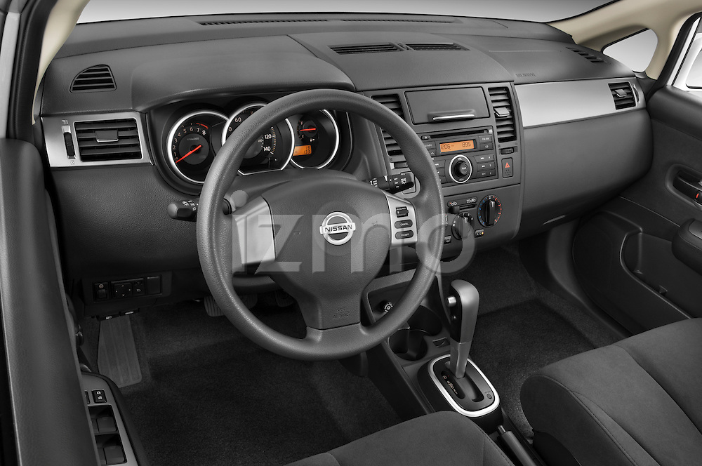 High angle dashboard view of a  2009 Nissan Versa Hatchback