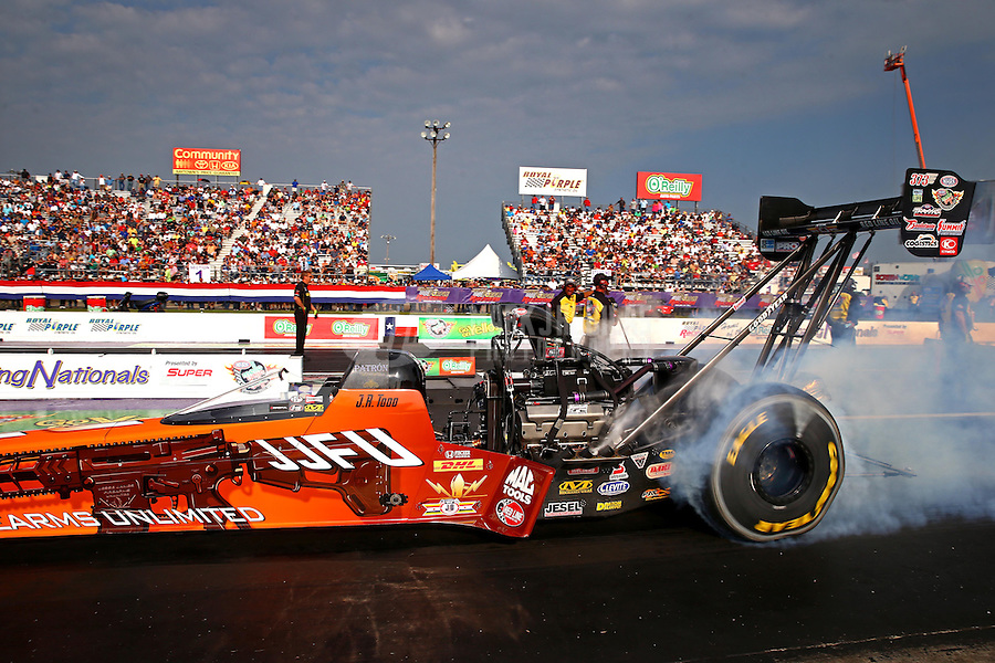 Apr 25, 2014; Baytown, TX, USA; NHRA top fuel dragster driver J.R. Todd during qualifying for the Spring Nationals at Royal Purple Raceway. Mandatory Credit: Mark J. Rebilas-