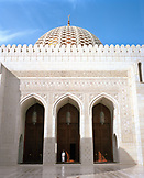OMAN, Middle East, Muscat, man standing by column of The Grand Mosque Sultan Qaboo