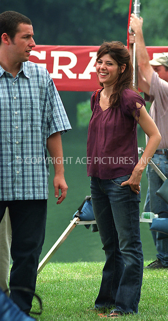 """Anger Management"" second day of filming at the same location in Central Park, New York. With temperatures reaching 95F, it is no fun making a movie, but the actors kept their spirits high as they were watched by a huge crowd of onlookers. Pictured are ADAM SANDLER and MARISA TOMEI. June 2, 2002. Please byline: Alecsey Boldeskul/NY Photo Press.   ..*PAY-PER-USE*      ....NY Photo Press:  ..phone (646) 267-6913;   ..e-mail: info@nyphotopress.com"