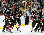 Drew Ellement (Northeastern - 2), ?, Tyler McNeely (Northeastern - 94), Wade MacLeod (Northeastern - 19) - The Boston College Eagles defeated the Northeastern University Huskies 5-4 in their Hockey East Semi-Final on Friday, March 18, 2011, at TD Garden in Boston, Massachusetts.