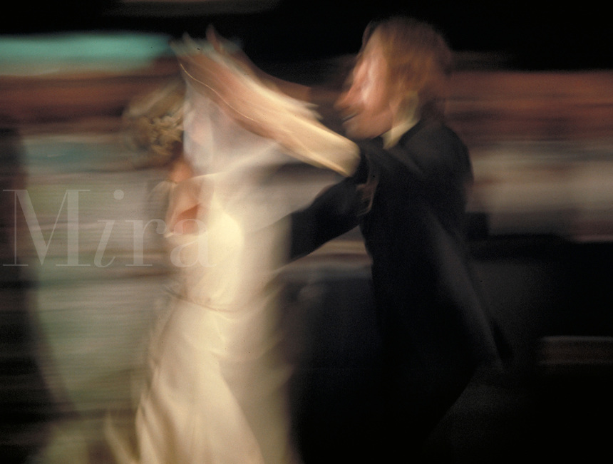Motion blurred image of a couple in formal wear ballroom dancing, couples, romance.