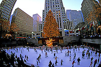New York City Rockefeller Center at Christmas with tree and ice skater