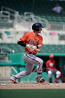 Baltimore Orioles Ben Breazeale (60) hits a single during a Florida Instructional League game against the Boston Red Sox on September 21, 2018 at JetBlue Park in Fort Myers, Florida.  (Mike Janes/Four Seam Images)