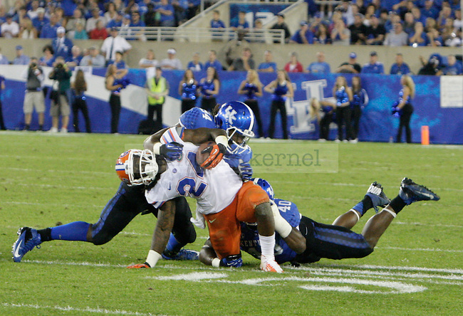 Florida Gators running back Matt Jones (24) is brought down by the Kentucky defense during the second half of the UK Football game against Florida at Commonwealth Stadium in Lexington, Ky., on Saturday, September, 28, 2013. Photo by Jonathan Krueger   Staff
