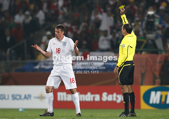 RUSTENBURG, SOUTH AFRICA - JUNE 12:  Jamie Carragher of England is booked by referee Carlos Simon during a 2010 FIFA World Cup soccer match against the United States June 12, 2010 in Rustenburg, South Africa.  NO mobile use.  Editorial ONLY.  (Photograph by Jonathan P. Larsen)