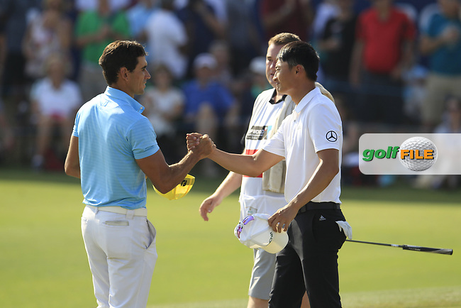 Rafa Cabrera Bello (ESP) and Haotong Li (CHN) on the 18th green during the final round of the DP World Tour Championship, Jumeirah Golf Estates, Dubai, United Arab Emirates. 18/11/2018<br /> Picture: Golffile | Fran Caffrey<br /> <br /> <br /> All photo usage must carry mandatory copyright credit (© Golffile | Fran Caffrey)