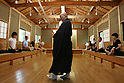 July 20, 2010 - Niiza, Japan - A Japanese Zen monk and and foreign tourists practice Zazen, a meditative discipline practitioners perform to calm the body and the mind, at Heirin-ji, a Rinzai temple of the Myoshin-ji branch located in Niiza city, Saitama prefecture, Japan, on July 20, 2010. The activity is part of the 'True Japan Saitama - Zen Medidation and Buddhist Vegetarian Cuisine' tour, organized by the travel agency JTB for leisure travelers.