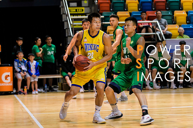 Fong Shing Yee #22 of Winling Basketball Club handles the ball against the Tycoon during the Hong Kong Basketball League playoff game between Winling and Tycoon at Queen Elizabeth Stadium on July 24, 2018 in Hong Kong. Photo by Marcio Rodrigo Machado / Power Sport Images