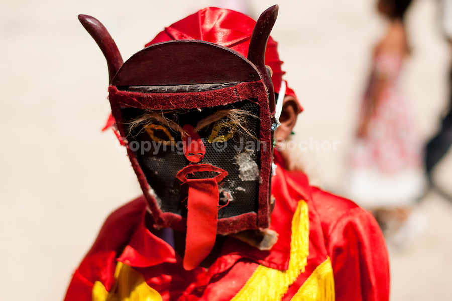 """The Devil dancer (Diablo) takes part in the religious procession in Atanquez, Sierra Nevada, Colombia, 3 June 2010. A colorful celebration of Corpus Christi is held in the Kankuamo Indians territory every year. """"The Dance of the Devils"""" is an ancient tradition kept for centuries on the Colombia's Caribbean coast. This Christian religious event usually coincides with the summer solstice, which has always been the key point for the native cultures and for the black African slaves. Due to this confluence, the Kankuamo myths, the African animistic rites and other Pre-Columbian features have blended with the Spanish Catholic festival into a lively spectacle."""
