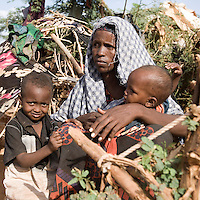 Kenya - Dadaab – 21st July 2011. Adey Salat, 23 years old, come from Dinsor, near the city of Baidoa. He arrived at Ifo camp five months ago, after having left her husband in Somalia. She struggles to get enough food supplies for her five kids, having to trade some of it for tea leaves and milk, which are not provided at the food distribution centers. Because of the increased demand, sometimes she doesn't even manage to get water from the water point, after spending hours in queue.