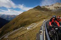 Touring cyclists climb steep rung of switchbacks - Switzerland