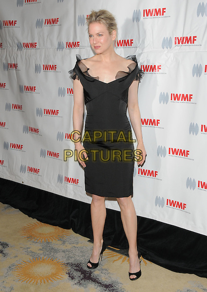 RENEE ZELLWEGER .attends The International Women's Media Foundation's Courage in Journalism Awards held at The Beverly Hills Hotel in Beverly Hills, California, USA, October 16th 2008                                                                     .full length black ruffle trim dress off the shoulder open toe shoes .CAP/DVS.©Debbie VanStory/Capital Pictures
