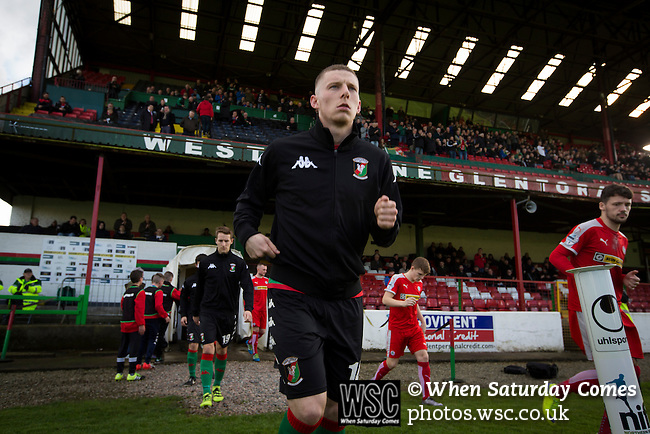 Glentoran 2 Cliftonville 1, 22/10/2016. The Oval, NIFL Premiership. Home players comimg on to the pitch at The Oval, Belfast before Glentoran hosted city-rivals Cliftonville in an NIFL Premiership match. Glentoran, formed in 1892, have been based at The Oval since their formation and are historically one of Northern Ireland's 'big two' football clubs. They had an unprecendentally bad start to the 2016-17 league campaign, but came from behind to win this fixture 2-1, watched by a crowd of 1872. Photo by Colin McPherson.