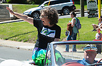 WINSTED,  CT-051819JS06- Parade marshal Amy Wynn, Executive Director of the American Mural Project, waves to the crowd during the 83rd annual Rotary Club Pet Parade along Main Street in Winsted on Saturday. <br /> Jim Shannon Republican American