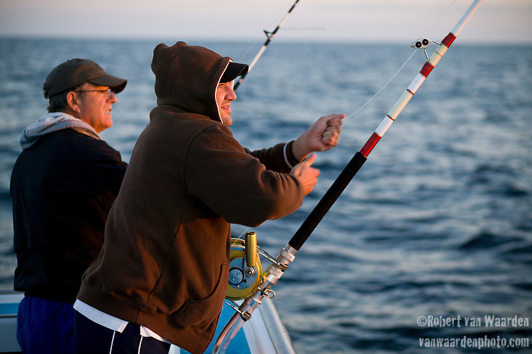 Sunrise greets two fisherman that are blue fin tuna fishing on the Gulf of St. Lawrence near North Rustico, Prince Edward Island, Canada.