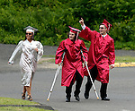 Wolcott, CT- 13 June 2016-061316CM07-  Wolcott High School graduates Rebecca Secula, Nick Garcia and Alex Wabuda celebrate before the start of commencement exercises on Monday.    Christopher Massa Republican-American
