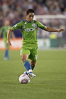 Seattle Sounders forward David Estrada (16) passes the ball. In a Major League Soccer (MLS) match, the Seattle Sounders FC defeated the New England Revolution, 2-1, at Gillette Stadium on October 1, 2011.