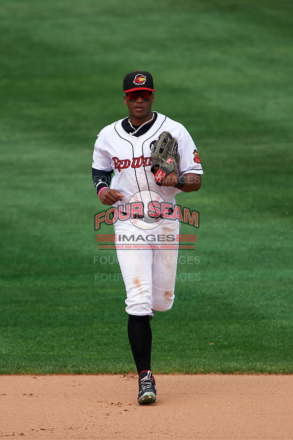 Rochester Red Wings left fielder Adam Walker (30) jogs to the dugout in between innings during a game against the Columbus Clippers on June 16, 2016 at Frontier Field in Rochester, New York.  Rochester defeated Columbus 6-2.  (Mike Janes/Four Seam Images)
