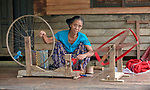 Niang Ngaih Cin, an ethnic Chin woman in Tuingo, Myanmar, spins thread in front of her home.