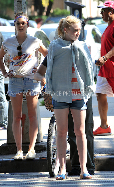 WWW.ACEPIXS.COM . . . . .  ....July 12 2012, New York City....Actresses Elizabeth Olsen (L) and Dakota Fanning on the Brighton Beach set of the new movie 'Very Good Girls' on July 12 2012 in New York City....Please byline: CURTIS MEANS - ACE PICTURES.... *** ***..Ace Pictures, Inc:  ..Philip Vaughan (212) 243-8787 or (646) 769 0430..e-mail: info@acepixs.com..web: http://www.acepixs.com