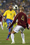 06 June 2008: Robinho (BRA) (11) is watched by Jonay Hernandez (VEN) (4). The Venezuela Men's National Team defeated the Brazil Men's National Team 2-0 at Gillette Stadium in Foxboro, Massachusetts in an international friendly soccer match.