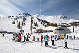 USA, California, Mammoth, skiers and snowboarders wait in line to ride the chairlift at Mammoth Ski Resort