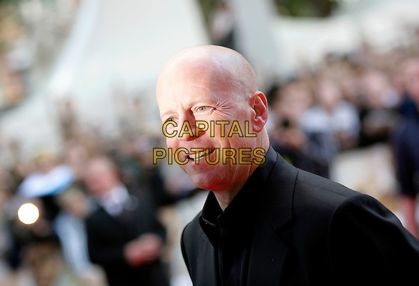 "BRUCE WILLIS.Leaving the UK premiere of ""Die Hard 4.0: Live Free or Die Hard"" at the Empire Leicester Square, London, England..June 20th, 2007.headshot portrait .CAP/CAM.©Andre Camara/Capital Pictures"